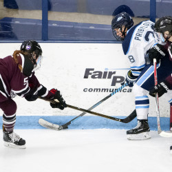 University of Maine's Vendula Pribylova (center) battles for the puck with Union College's Ava Reynolds (left) and Katie Laughlin during their hockey game on Friday at Alfond Arena in Orono.