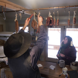 Matthew Secich helps Lori Perez at his Charcuterie store in Unity recently. Perez is one of many regular customers at Secich's shop, which sells unique smoked meat and cheese products. The Amish man's business had more then its fair share of ups and down throughout the past year.