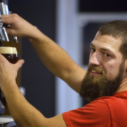 Head brewer Cory Ricker pours a beer at 2 Feet Brewing Co. in Bangor.