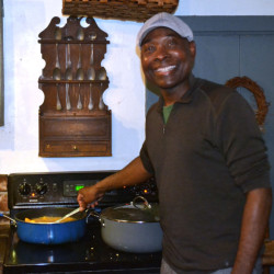 Messan Jordan Benissan prepares sweet potatoes, cooked in traditional Togolese fashion, for a community dinner at Patricia Stauble Antiques in Wiscasset on Dec. 8.
