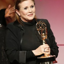 "Actress Carrie Fisher waits to present George Lucas (not seen) with the outstanding special class animated program for ""Star Wars: The Clone Wars"" as he makes his way to the stage during the 40th annual Daytime Emmy Awards in Beverly Hills, California, in this June 2013 file photo."