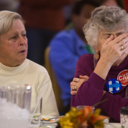 Marianne Fricke (right) covers her face after Donald Trump won another state while watching election results at the Hilton Garden Inn in Bangor on Nov. 8.