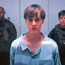 Dylann Storm Roof appears by closed-circuit television at his bond hearing in Charleston, South Carolina, U.S. June 19, 2015 in a still image from video.