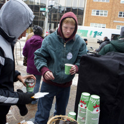 Members of the community enjoy hot cocoa and cookies as part of the United Way Day of Thanks on Thursday in West Market Square in Bangor. Throughout the day, teams of volunteers and partnering agencies throughout the five counties in Eastern Maine delivered random acts of kindness to individuals, organizations and companies.