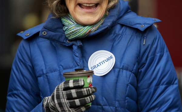 A woman laughs while enjoying a hot cocoa as part of the United Way Day of Thanks on Thursday in West Market Square in Bangor. Throughout the day, teams of volunteers and partnering agencies throughout the five counties in Eastern Maine delivered random acts of kindness to individuals, organizations and companies.
