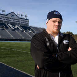 Former University of Maine lineman Dan Carriker, who was forced to stop playing football after suffering his third concussion during preseason training in August 2015, poses for a photo in Orono in this December 2015 file photo.