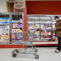 Robert Smith picks out food items from the Save-A-Lot grocery store in Dover-Foxcroft one day in late November.
