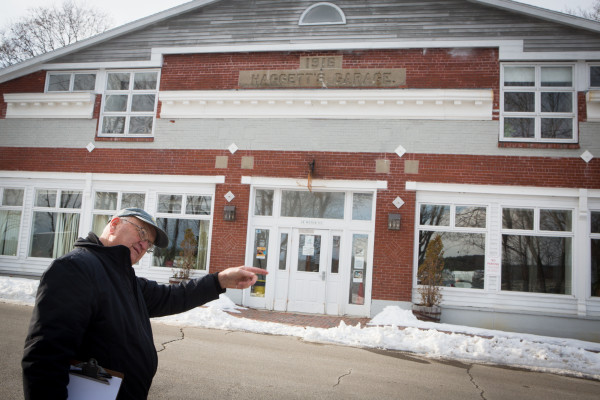 Bill Sutter, spokesman for the Wiscasset Taxpayers Alliance, points out a downtown building he said was once considered as a location for a parking lot on Thursday in Wiscasset.