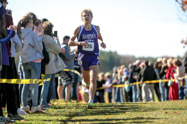Hampden's Paul Casavant rounds a light bend just past the two-mile point of the Class A state championship cross country meet in Cumberland in this 2015 file photo.