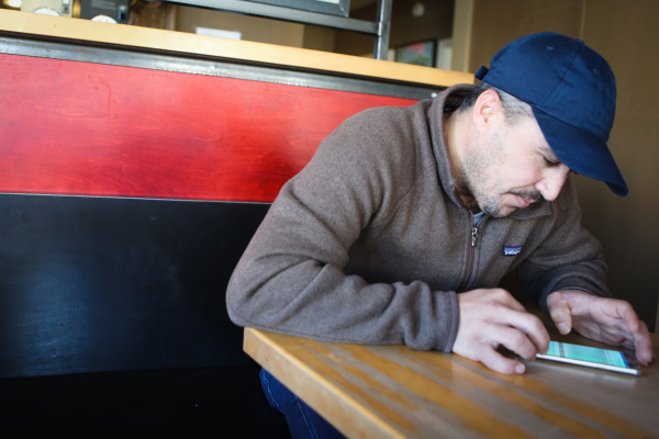 Nadir Alzoubi uses a translation app on his phone to communicate with a reporter at a coffee shop in Portland last month. Alzoubi and his family, including his wife, Jamila and their four children, were among the first Syrian refugees resettled in Maine since the outbreak of the county's civil war.
