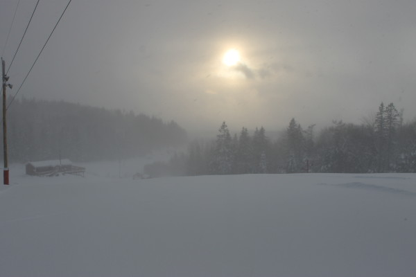 The sun peaks out as a snow squall swept over Presque Isle Thursday afternoon, as seen from the slopes of the Quoggy Joe Ski Club.