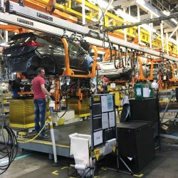 Workers assemble Chevy Bolt EV cars at the General Motors assembly plant in Orion Township, Michigan, on Nov. 4, 2016.