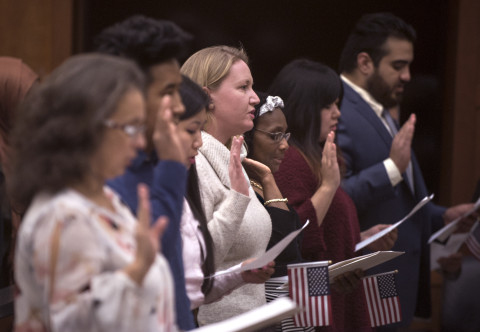People take the Oath of Allegiance during a naturalization ceremony at the Margaret Chase Smith Federal Building in Bangor, Nov. 21, 2016.