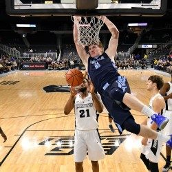 University of Maine forward Andrew Fleming dunks the ball in front of Providence Friars guard Jalen Lindsey during the second half at the Dunkin Donuts Center in Providence, R.I., on Tuesday night. The Friars won 79-59.