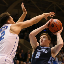 University of Maine freshman Andrew Fleming of South Paris (right), pictured during a Dec. 3 game at Duke, registered his first career double-double with 12 points and 11 rebounds in Tuesday night's loss at Providence. The Black Bears return to action on Thursday at Brown.