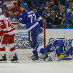 Tampa Bay Lightning goalie Ben Bishop (30) grimaces in pain during the first period against the Detroit Red Wings at Amalie Arena in Tampa, Florida, on Tuesday, Dec. 20, 2016. Bishop left the game after the play.