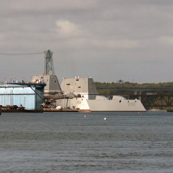 The USS Zumwalt (DDG 1000) passes the future USS Michael Monsoor (DDG 1001) as Zumwalt departs Bath Iron Works, marking the beginning of a 3-month journey to its new homeport in San Diego, on Sept. 7.