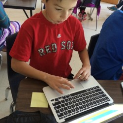 Sixth-grader Brad Charest works on a project about fake news at Portland's Lyman Moore Middle School.