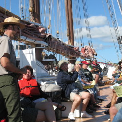 Acadia National Park Ranger Kirk Lurvey leads a talk on a sail boat during the summer of 2016. Lurvey is conducting the talk through an agreement between the boat tour company and the park.