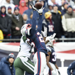 New England Patriots cornerback Eric Rowe (25) intercepts a pass intended for New York Jets wide receiver Brandon Marshall (15) during the first half of Saturday's NFL game at Gillette Stadium. The Patriots won 41-3.
