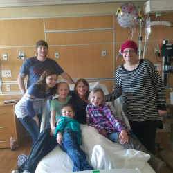 Sylvia Page, in hospital bed, celebrated Christmas at Eastern Maine Medical Center surrounded by family.