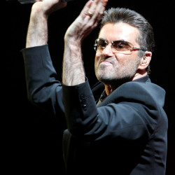 British singer George Michael performs on the first night of the British leg of his tour at the MEN Arena in Manchester, northern England, Nov. 17, 2006.