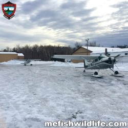 Two Maine Warden Service aircraft are shown at Millinocket Municipal Airport on Monday. The aircraft were used in efforts to find three lost snowmobilers.