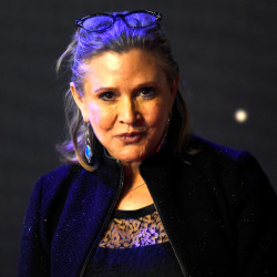"Carrie Fisher poses for cameras as she arrives at the European Premiere of ""Star Wars, The Force Awakens"" in Leicester Square, London, Dec. 16, 2015."