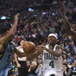 Boston Celtics guard Isaiah Thomas (4) drives to the basket between Memphis Grizzlies guard Andrew Harrison (5) and guard Tony Allen (9) during the second half at TD Garden. The Celtics won 113-103.