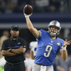 Detroit Lions quarterback Matthew Stafford (9) throws a pass as head coach Jim Caldwell looks on before the game against the Dallas Cowboys at AT&T Stadium.
