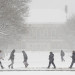 Students walk across the University of Maine through a snowstorm in March.