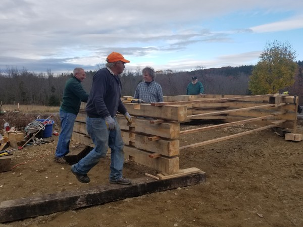 Volunteers assemble the wooden components of a mortise and tenon structure being built at the Curran Homestead in November. The new building will serve as the farming museum's wood working shop once it is completed.