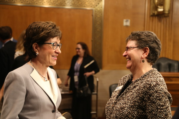 Sen. Susan Collins (left) chats with Betty Balderston of Winthrop at a hearing before the U.S. Senate Special Committee on Aging in 2015. Balderston is statewide coordinator for the Maine Senior Medicare Patrol, a network of volunteers that provides education and counseling to Medicare beneficiaries.