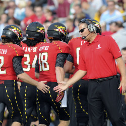 Maryland coach Randy Edsall (right) congratulates kicker Brendan Magistro (left) after kicking a field goal during their football game against Boston College at Alumni Stadium in Boston in this October 2012 file photo.