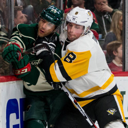 Pittsburgh Penguins defenseman Brian Dumoulin (right) hits Minnesota Wild forward Jason Pominville during their hockey game at Xcel Energy Center in Saint Paul, Minnesota, in this November 2016 file photo.