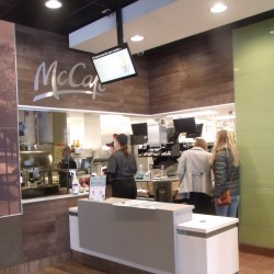 Residents and employees tour behind the counter and the McCafe area of the new McDonald's on Wednesday in Houlton.