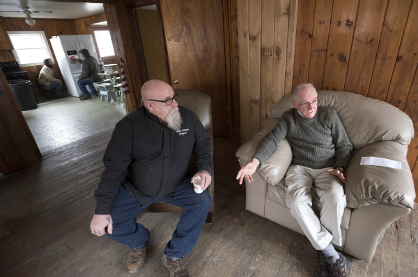 Garry Owen House board of directors President Lou Pelletier (right), 80, and Garry Owen Motorcycle Club President Warren Ard, 59, talk about the mission of the Garry Owen House on Wednesday in Searsmont. The building offers transitional housing to homeless veterans.