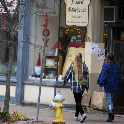 Shoppers walk in downtown Bangor the day after Thanksgiving.