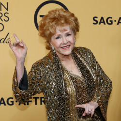 Actress Debbie Reynolds poses backstage after accepting her Lifetime Achievement awards at the 21st annual Screen Actors Guild Awards in Los Angeles, California, in this January 2015 file photo.