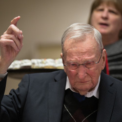"""Woodrow Cross gets a bit choked up as employees sing """"Happy Birthday"""" to him during his 100th birthday celebration on Thursday at the headquarters of Cross Insurance, a business he started more than six decades ago, in Bangor. Cross hasn't stopped working since he started selling seed out of a wagon strapped to his pony in 1923."""