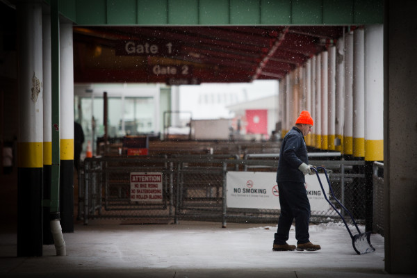 Lloyd Jones shovels snow off a portion of the Casco Bay Lines terminal in Portland on Thursday.