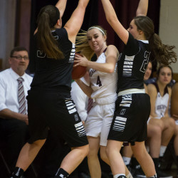 Foxcroft Academy's Alli Bourget (center) tries to get the ball past Houlton's Aspen Flewelling (left) and Kristen Graham during their basketball game in Dover-Foxcroft Thursday.