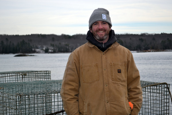 Ryan McPherson, the new owner of Glidden Point Oyster Sea Farm, stands on the dock of 637 River Road, the new headquarters for the business, on Tuesday, Dec. 20.