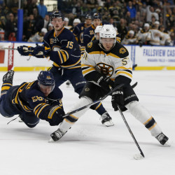 Buffalo Sabres defenseman Rasmus Ristolainen (55) dives in an attempt to block a shot by Boston Bruins center Ryan Spooner (51) during the third period at KeyBank Center in Buffalo, New York. Spooner scored twice in the third period as Boston beat Buffalo 4-2.