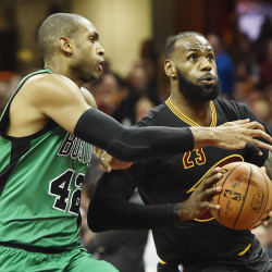 Cleveland Cavaliers forward LeBron James (23) drives to the basket against Boston Celtics center Al Horford (42) during the first half at Quicken Loans Arena in Cleveland.