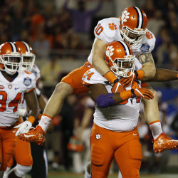 Clemson Tigers defensive tackle Carlos Watkins (94) is congratulated by linebacker Ben Boulware (10) after his sack against the Virginia Tech Hokies during the second half of the ACC Championship college football game at Camping World Stadium in Orlando on Dec. 3. Clemson Tigers defeated the Virginia Tech Hokies 42-35.