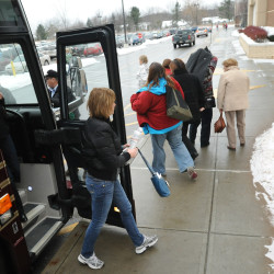 Shoppers head for stores at the Bangor Mall as soon as their bus arrives from St. John, New Brunswick, in this December 2010 photo. Bangor City Council Chairman Joe Baldacci wants to revive the St. John-Bangor connection to encourage increased tourism.