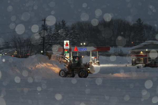 A plow moves snow on Friday in Fort Kent.