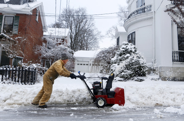 Glen Porter maneuvers his snowblower while clearing his driveway in Bangor Friday morning.
