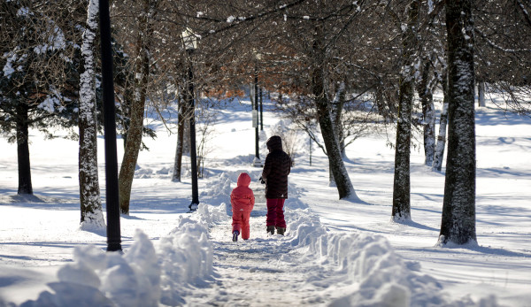 Marina Moscone (right) and her daughter Sasha, 4, take a walk through Chapin Park in Bangor on Friday.